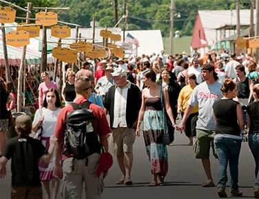Food and craft stands line the crowded midway of the Kutztown Folk Festival.