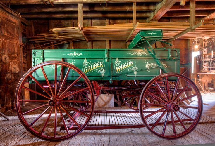 This green box wagon with yellow spindle wheels in on display at the Gruber Wagon, Berks County Heritage Center in Pennsylvania's Americana Region