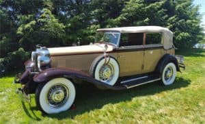 A beautiful cream and burgundy antique Packard sits on display at Boyertown Community Park. It is part of Boyertown Museum of Historic Vehicles' Duryea Day.