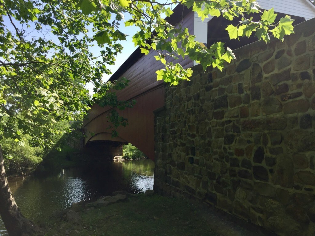A picture of the Pleansantville Bridge in Oley shows the bridge from an angle below the bridge.