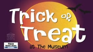 A block with Halloween inspired colors with the wording Trick or Treat at the Museum