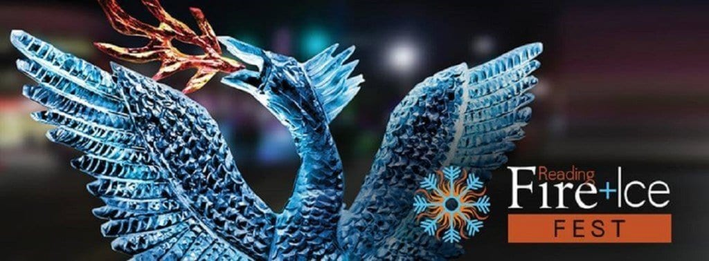 A beautiful, blue tinted ice carving of a mythological phoenix with wings spread and red flames coming from its mouth, makes for a spectacular sight against the night sky at Reading Fire + Ice Fest.