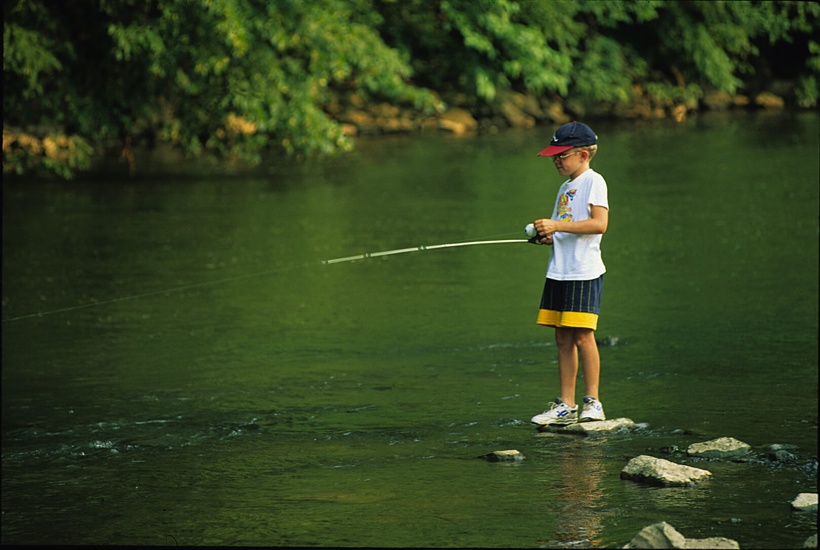 Kid fishing in Berks County creek.