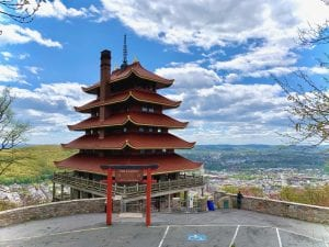 The Reading Pagoda sits against a blue sky dotted with clouds.
