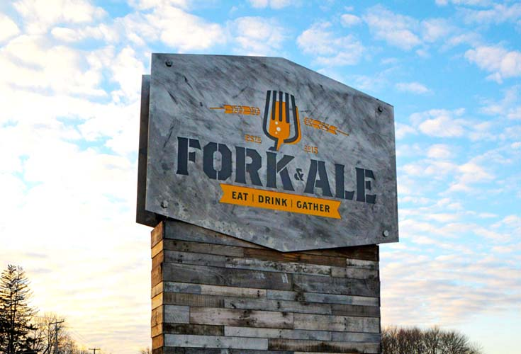 Sign in front of the Fork and Ale Restaurant with a Fork and the words Fork & Ale